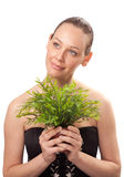 Beautiful young woman holding plant growing. Against white background Royalty Free Stock Photo