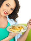 Beautiful Young Woman Holding a Plate of Delicious Cannelloni Spinach Pasta Royalty Free Stock Photography