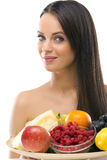 Beautiful young woman holding a plate with fresh fruit Royalty Free Stock Images
