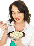 Beautiful Young Woman Holding a Plate of Italian Style Risotto Royalty Free Stock Image