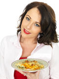 Beautiful Young Woman Holding a Plate of Spinach and Ricotta Cannelloni Pasta Stock Images