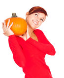 Beautiful young woman holding pumpkin and smiling Stock Image