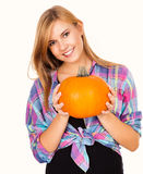 Beautiful young woman holding pumpkin and smiling Royalty Free Stock Photography