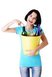 Beautiful young woman holding recycling bin Stock Photography