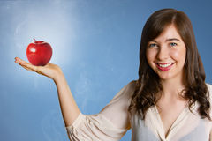 Beautiful young woman holding red apple Royalty Free Stock Photo