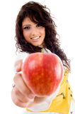 Beautiful young woman holding red apple Stock Images