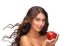 Beautiful young woman holding red apple Royalty Free Stock Photography