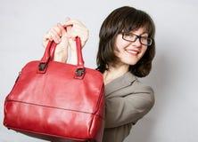 Beautiful young woman holding red bag Stock Photos