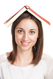 Beautiful young woman holding red book on her head Royalty Free Stock Image