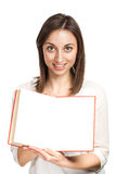 Beautiful young woman holding red book Royalty Free Stock Photos