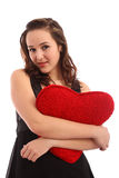 Beautiful young woman holding red heart Royalty Free Stock Image