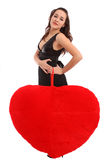 Beautiful young woman holding red heart Stock Photography