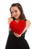 Beautiful young woman holding red heart Stock Photo