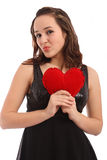 Beautiful young woman holding red heart Stock Image