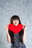 Beautiful Young Woman Holding Red Heart Royalty Free Stock Photography
