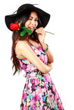 Beautiful young woman holding a red rose. And smiling at camera, Isolated over white royalty free stock images