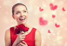 Beautiful young woman holding red roses Stock Images