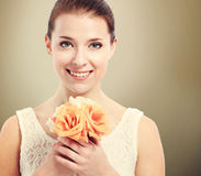 Beautiful young woman holding roses Stock Photos
