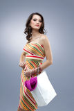 Beautiful young woman holding shopping bag Royalty Free Stock Images