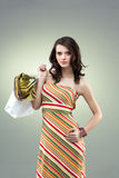 beautiful young woman holding shopping bag Stock Image