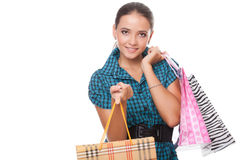 Beautiful  young woman holding shopping bags Royalty Free Stock Photo