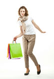 Beautiful young woman holding shopping bags Stock Images