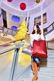 Beautiful young woman holding shopping bags Stock Image