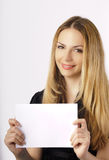 Beautiful young woman holding a sign Stock Photography