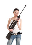 Beautiful young woman holding a sniper rifl. A beautiful young woman holding a sniper rifle, isolation on a white background Stock Photography