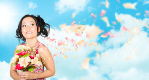 Beautiful young woman holding spring flower bunch Royalty Free Stock Photography