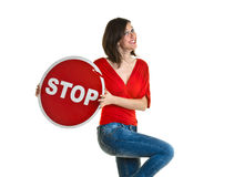 Beautiful young woman holding a stop sign Stock Photo