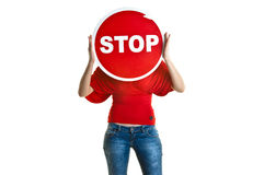Beautiful young woman holding a stop sign Royalty Free Stock Photography