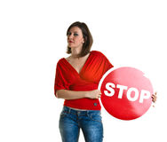Beautiful young woman holding a stop sign Stock Photography