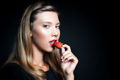 Beautiful young woman holding strawberry Royalty Free Stock Image
