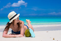 Beautiful young woman holding a suncream lying on Royalty Free Stock Photo