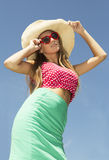 Beautiful young woman holding sunglasses Royalty Free Stock Images