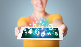 Young woman holding tablet with numbers Royalty Free Stock Image