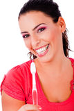 Beautiful young woman holding tooth brush Royalty Free Stock Photos