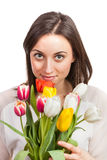 Beautiful young woman holding tulips isolated on w Royalty Free Stock Photography