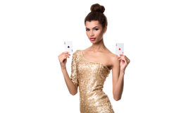 Beautiful young woman holding two ace of cards in her hand isolated on white Stock Photography