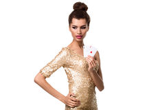 Beautiful young woman holding two ace of cards in her hand isolated on white Stock Image