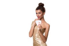 Beautiful young woman holding two ace of cards in her hand isolated on white Stock Photos