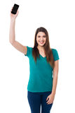Beautiful young woman holding up a cell phone Royalty Free Stock Images