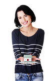 Woman holding US dollars bills and house model Royalty Free Stock Photography