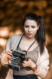 Beautiful Young Woman Holding Vintage Old Camera Stock Photography