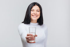 Beautiful young woman holding water glass Stock Images