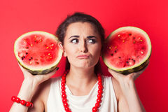 Beautiful young woman holding watermelon Stock Image