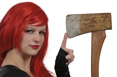 Woman with an axe. Beautiful young woman holding a wooden handled axe Royalty Free Stock Images