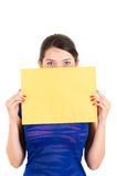 Beautiful young woman holding yellow blank sign Stock Photo