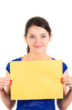 Beautiful young woman holding yellow blank sign Royalty Free Stock Photography